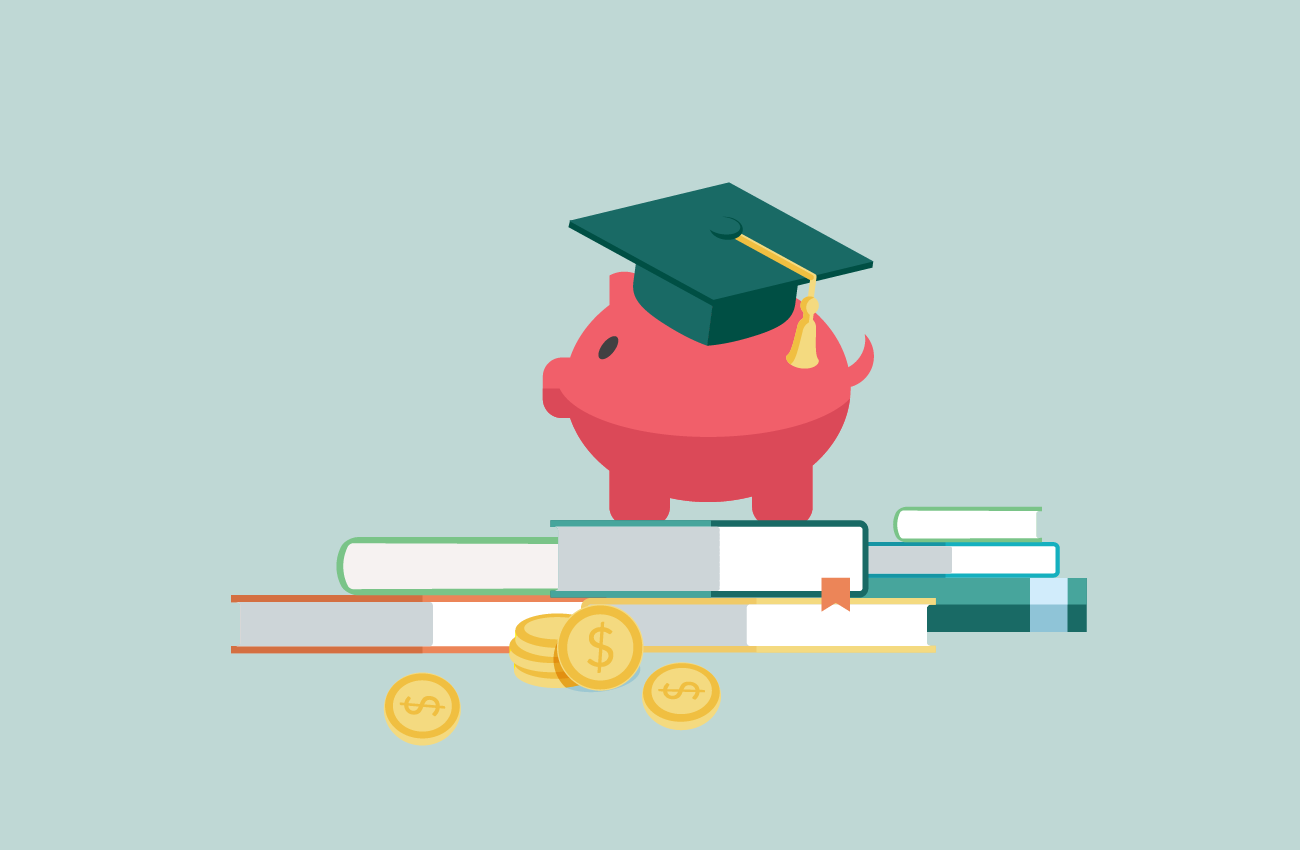 Graduating piggybank with books and coins