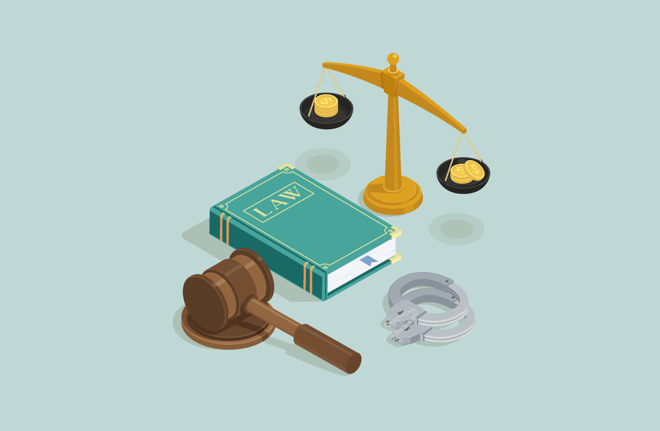 Law book, gavel, scale and handcuffs