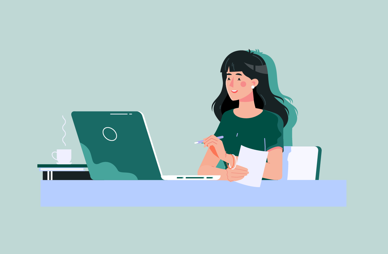 Left-handed woman browsing on laptop.